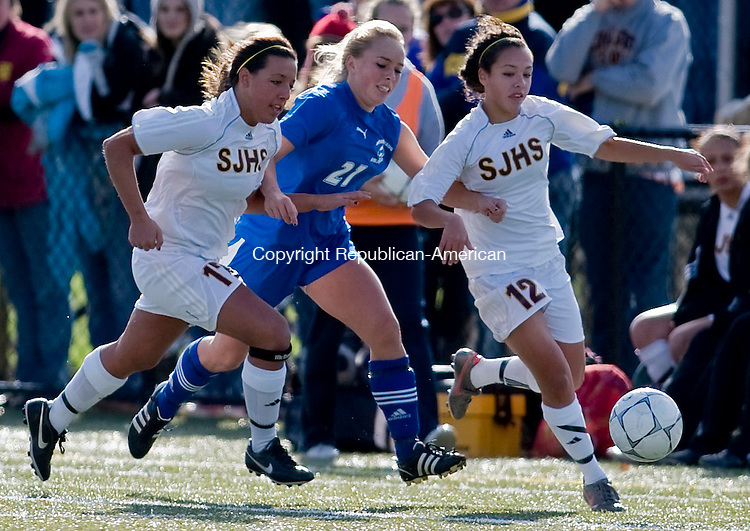 WATERBURY, CT - 16 NOVEMBER 2008 -111608JT03-<br /> Nonnewaug's Kati Florin runs between St. Joseph's #17 Samantha Toohey and #12 Brittany Peralta during Sunday's Class M final at Municipal Stadium in Waterbury. St. Joseph won 1-0.<br /> Josalee Thrift / Republican-American