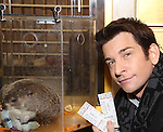 """Andy Karl with Staten Island Chuck visit the """"Groundhog Day'' opening day box office at The August Wilson Theatre on February 2, 2017 in New York City."""