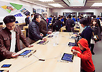 People at Apple store trying new iPhones. Ginza, Tokyo, Japan 2014