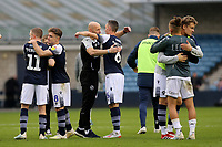 Millwall Caretaker Manager, Adam Barrett embraces Shaun Williams of Millwall after their victory at the final whistle during Millwall vs Leeds United, Sky Bet EFL Championship Football at The Den on 5th October 2019