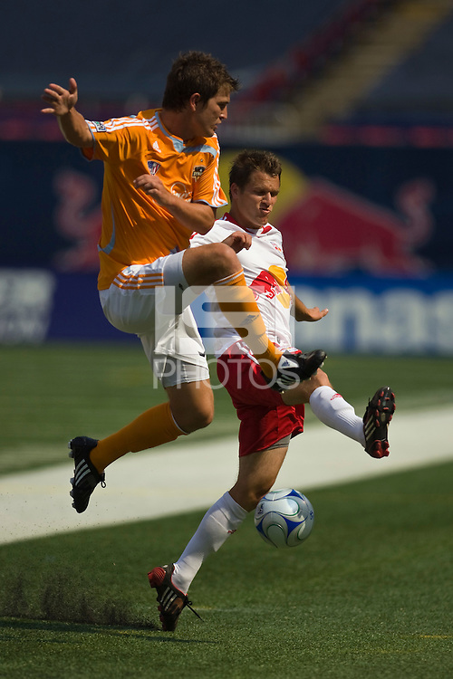 Houston Dynamo defender Bobby Boswell (32) and New York Red Bulls midfielder Seth Stammler (6). The New York Red Bulls defeated the Houston Dynamo 3-0 during a Major League Soccer match at Giants Stadium in East Rutherford, NJ, on August 24, 2008.