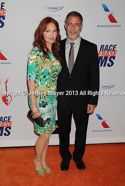 CENTURY CITY, CA- MAY 03: Actress Amy Yasbeck and guest arrive at the 20th Annual Race To Erase MS Gala 'Love To Erase MS' at the Hyatt Regency Century Plaza on May 3, 2013 in Century City, California.