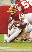 Washington Redskins running back Stephen Davis (48) is brought down by Arizona Cardinals defensive end Fred Wakefield (97) after a four yard gain in first quarter action of the game in Landover, Maryland on January 6, 2002. The Redskins won the game 20 - 17.<br /> Credit: Ron Sachs / CNP
