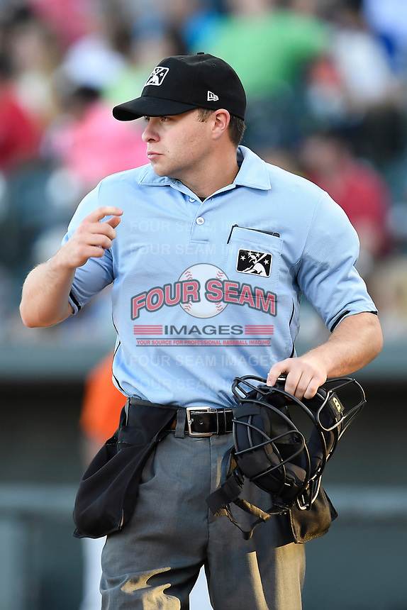 Umpire John Budka Jr. works a game between the Augusta GreenJackets and Columbia Fireflieon Sunday, July 30, 2017, at Spirit Communications Park in Columbia, South Carolina. Augusta won, 6-0. (Tom Priddy/Four Seam Images)