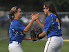 Sam Reyes #31, East Meadow right fielder, right, gets congratulated by center fielder #11 Jess Marsala after making a difficult catch in the top of the sixth inning Game 3 of the Nassau County varsity softball Class AA final against Long Beach at Mitchel Athletic Complex on Friday, May 26, 2017. East Meadow went on to win 3-1 to take the best-of-three series two games to one.