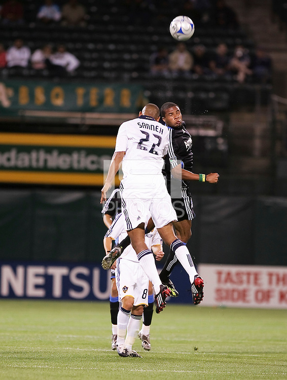Tony Sanneh (22) goes up for the header against Ryan Johnson (19). San Jose Earthquakes tied Los Angeles Galaxy 1-1 at the McAfee Colisum in Oakland, California on April 18, 2009.