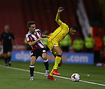 Stefan Scougall of Sheffield Utd tussles with Daniel Leadbetter of Bristol Rovers during the League One match at Bramall Lane Stadium, Sheffield. Picture date: September 27th, 2016. Pic Simon Bellis/Sportimage