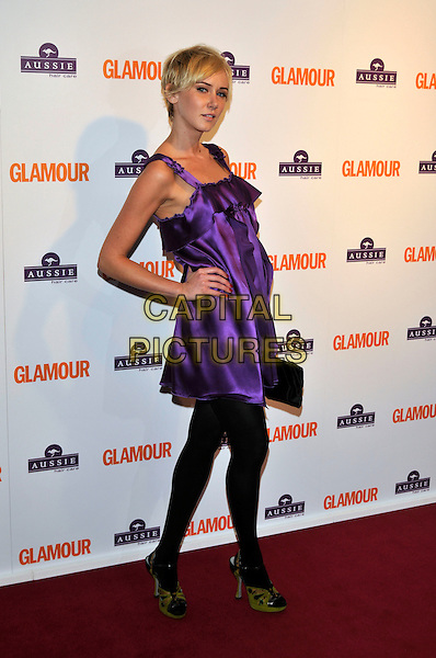 KIMBERLY STEWART.Inside Arrivals at the Glamour Women of the Year Awards 2008 held at Berkeley Square Gardens, London, England,.3rd June 2008.full length purple dress hand on hip black tights green open toe shoes clutch bag ruffle.CAP/PL.©Phil Loftus/Capital Pictures