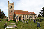 Graves in the churchyard of the village parish church of Saint Mary, Ellingham, Norfolk, England, UK