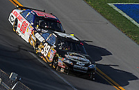 Apr 26, 2009; Talladega, AL, USA; NASCAR Sprint Cup Series driver Ryan Newman leads Dale Earnhardt Jr during the Aarons 499 at Talladega Superspeedway. Mandatory Credit: Mark J. Rebilas-
