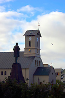 The statue of Iceland's national hero, Jon Sigurdsson, created by Einar Jonsson, at Austurvollur in downtown Reykjavik, the capital of Iceland. Domkirkjan, a historic church, in the background.