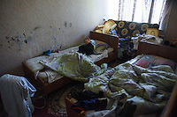 Little Anton sleeps on the bed of the dormitory for IDPs in Stakhanov, Eastern Ukraine, Thursday, May 21, 2015