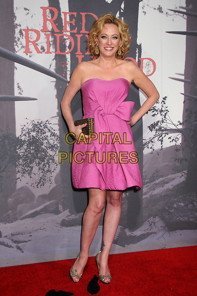 "VIRGINA MADSEN.""Red Riding Hood"" Los Angeles Premiere held at Grauman's Chinese Theatre,  Hollywood, California, USA, .7th March 2011..arrivals full length pink strapless dress gold clutch bag hand on hip peep toe glittery shoes .CAP/ADM/BP.©Byron Purvis/AdMedia/Capital Pictures."