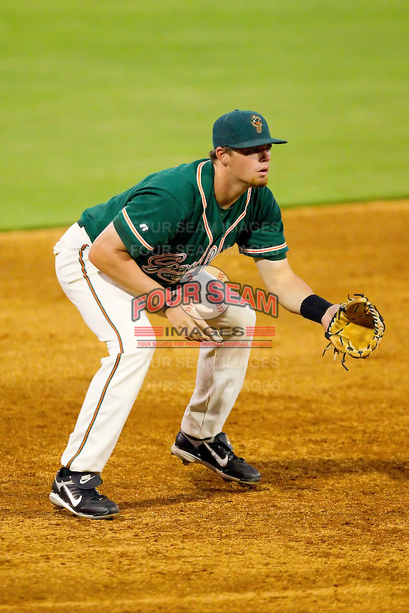 Third baseman Taylor Krick #17 of the Greensboro Grasshoppers on defense against the Kannapolis Intimidators at Fieldcrest Cannon Stadium August 2, 2010, in Kannapolis, North Carolina.  Photo by Brian Westerholt / Four Seam Images