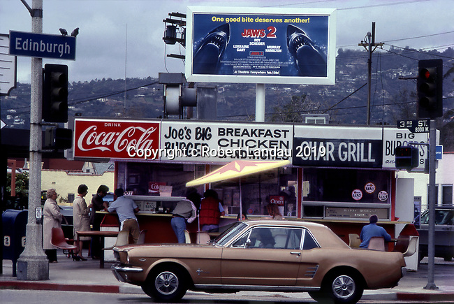 Joe's Big Burger stand on third at Edinburgh with classic Mustang passing circa 1978