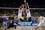 LOS ANGELES - MAY 5:  Daenan Gyimah #16 of the UCLA Bruins spikes the ball against Nick Amado #25 and Kyle Ensing #5 of the Long Beach State 49ers during the Division 1 Men's Volleyball Championship on May 5, 2018 at Pauley Pavilion in Los Angeles, California. The Long Beach State 49ers defeated the UCLA Bruins 3-2. (Photo by John W. McDonough/NCAA Photos via Getty Images)