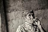 INDONESIA, Flores, an elder man Rufus Goa has a smoke in Kampung Tutubhada village in Rendu