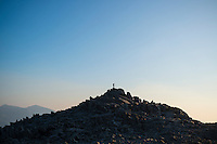 Silhouette of lone hiker on rocky summit of Glyder Fach, Snowdonia national park, Wales