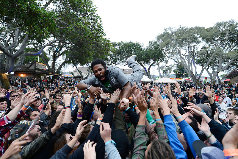 """""""Flying"""" Jay Armant of Fishbone crowdsurfs during the 2015 CaliRoots Festival in Monterey, California."""