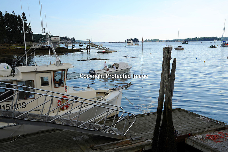 Motor Boat Heading Out in Maine, USA
