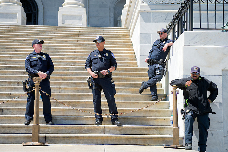 UNITED STATES - APRIL 14: U.S. Capitol Police stand guard on the Senate steps on the East Front of the Capitol, April 14, 2016. (Photo By Tom Williams/CQ Roll Call)