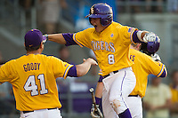 LSU Tigers outfielder Mason Katz #8 celebrates hitting a first inning home run during the NCAA Super Regional baseball game against Stony Brook on June 10, 2012 at Alex Box Stadium in Baton Rouge, Louisiana. Stony Brook defeated LSU 7-2 to advance to the College World Series. (Andrew Woolley/Four Seam Images).