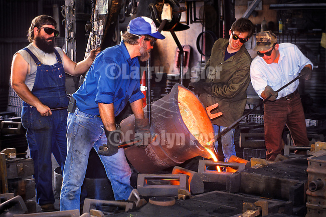 An iron pour into sand molds at the Knight Foundry, Sutter Creek, in the mid 1990s: <br /> <br /> Russell, Ed Arata, Robin Peters, Louis Boitano.<br /> <br /> Photo by Carolyn Fox.