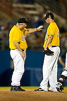 June 07, 2009:  NCAA Super Regional: Southern Miss Golden Eagles vs Florida Gators:    Southern Miss head coach Corey Palmer talks with his pitcher Scott Copeland (34) during game two of Super Regional action at Alfred A. McKethan Stadium on the campus of University of Florida in Gainesville.  Southern Miss came from behind to defeat Florida 7-6 and to advance to the College World Series.   ...........