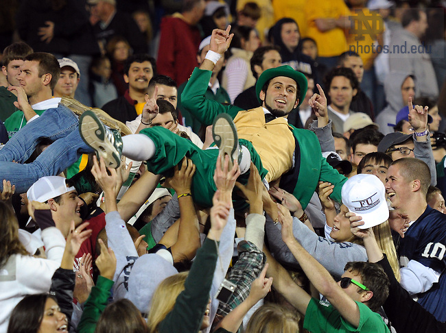 The Notre Dame Leprechaun celebrates with fans after a Notre Dame Fighting Irish touchdown against the Boston College Eagles in the third quarter at Alumni Stadium. Notre Dame won 31-13.