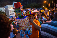 RIO DE JANEIRO, BRAZIL - FEBRUARY 23, 2014: An outpatients of the Instituto Philippe Pinel psychiatric hospital, stands with a manequin made of empty boxes of prescription medecine that is used to treat schizophrenia and bipolar disorder, during the annual T&aacute; Pirando, Pirado, Pirou! carnival street parade on February 23, 2014 in Rio De Janeiro, Brazil. It looks like any of the other 450 or so street parties, locally called &ldquo;carnival blocks,&rdquo; that parade through Rio de Janeiro during the raucous pre-Lenten festivities that draw hundreds of thousands to the city each year. What makes this party different are its performers and organizers: psychiatric patients and their doctors, therapists, family members, neighbors and passers-by. The group, called T&aacute; Pirando, Pirado, Pirou!, which roughly translates as &ldquo;We&rsquo;re freaking out, we already freaked out!&rdquo;, began ten years ago when Brazil was in the process of dismantling its century-old system of mental asylums. A law passed in 2001 called for long-term outpatient psychiatric care to be offered primarily in community clinics. The number of such clinics increased more than fivefold in the following decade, while the number of asylum beds for psychiatric patients dropped 40 percent nationwide.<br /> <br /> Daniel Berehulak for The New York Times