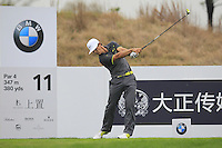 Thorbjorn Olesen (DEN) tees off the 11th tee during Friday's Round 2 of the 2014 BMW Masters held at Lake Malaren, Shanghai, China 31st October 2014.<br /> Picture: Eoin Clarke www.golffile.ie