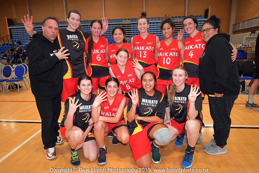 Waikato celebrate their fourth title in a row after winning the National Under-23 Basketball Championship women's final between Waikato and Otago at Te Rauparaha Arena in Porirua, New Zealand on Saturday, 10 August 2019. Photo: Dave Lintott / lintottphoto.co.nz