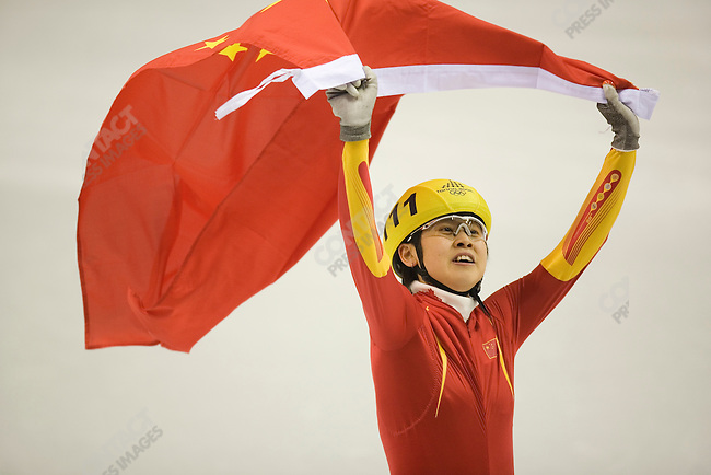 Short track women's 500m final at the Palavela during the Torino Winter Olympics. Gold medal winner Meng Wang of CHN.