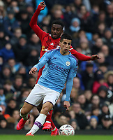 26th January 2020; Etihad Stadium, Manchester, Lancashire, England; English FA Cup Football, Manchester City versus Fulham; Joao Cancelo of Manchester City wins the ball
