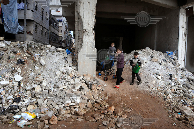 A group of children in a heavily battle-damaged building near the frontline in Hamdaniya, a suburb on the city's outskirts.