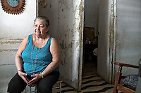 Images from the old Havana, Cuba, Latin America. ..Fidelina, Encanito's wife watching TV with her door open, keeping an eye on life on the street.