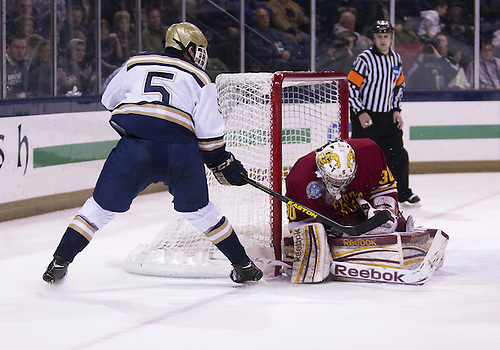 January 25, 2013:  Ferris State goaltender CJ Motte (30) makes the save on shot by Notre Dame defenseman Robbie Russo (5) during NCAA Hockey game action between the Notre Dame Fighting Irish and the Ferris State Bulldogs at Compton Family Ice Arena in South Bend, Indiana.  Ferris State defeated Notre Dame 3-1.