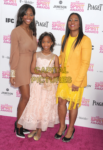 Quvenzhane Wallis, Qunyquekya Wallis, Qulyndreia Wallis.2013 Film Independent Spirit Awards - Arrivals Held At Santa Monica Beach, Santa Monica, California, USA,.23rd February 2013..indy indie indies indys full length pink dress dog bag purse beige yellow.CAP/ROT/TM.©Tony Michaels/Roth Stock/Capital Pictures