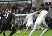 Barclays Premier League, Swansea City (White) V Norwich City (black) Liberty Stadium, Swansea, 08/12/12<br /> Pictured: Swansea's Ki Sung-yeung with this first half free kick<br /> Picture by: Ben Wyeth / Athena <br /> Athena Picture Agency<br /> info@athena-pictures.com