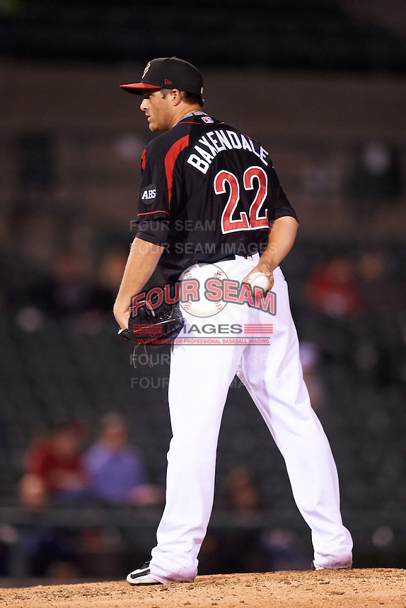 Rochester Red Wings relief pitcher D.J. Baxendale (22) looks in for the sign during a game against the Syracuse Chiefs on July 1, 2016 at Frontier Field in Rochester, New York.  Rochester defeated Syracuse 5-3.  (Mike Janes/Four Seam Images)