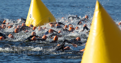 25 AUG 2013 - STOCKHOLM, SWE - Competitors start in their wave of the Stockholm Triathlon in Stockholm, Sweden (PHOTO COPYRIGHT © 2013 NIGEL FARROW, ALL RIGHTS RESERVED)
