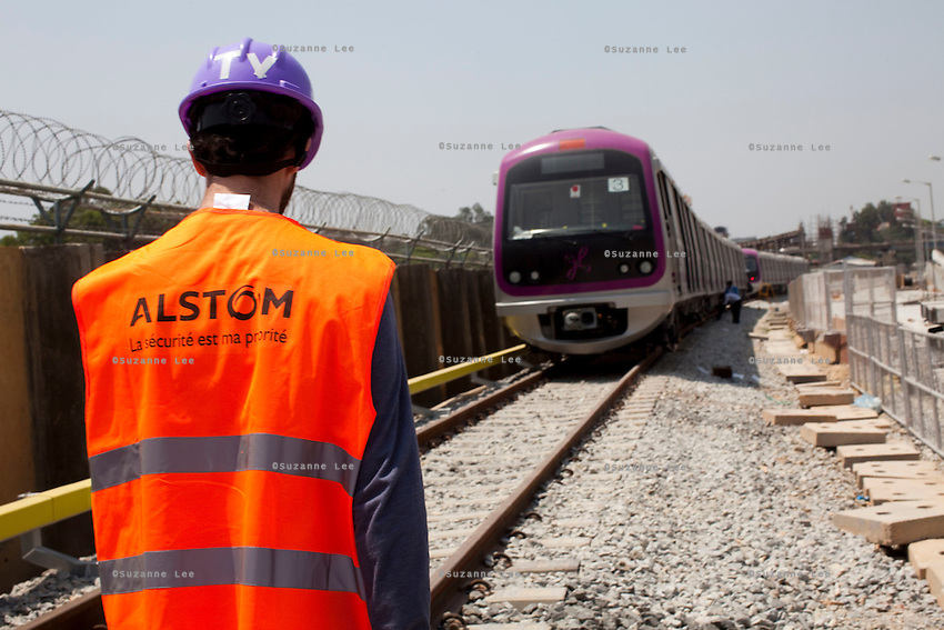An ALSTOM worker walks near the Third Line Power Supply rails (yellow rails, left) in the Baiyappanahalli depot station in Bangalore, Karnataka, India on 10th March 2011. .Photo by Suzanne Lee/Abaca Press