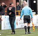 Alloa Manager Paul Hartley is upset at the stand side assistant referee.