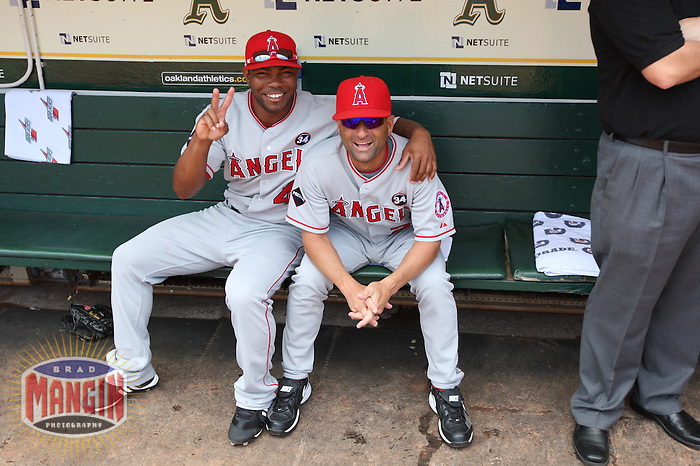 OAKLAND, CA - JULY 18:  Howard Kendrick #47 (left) and coach Dino Ebel #21 of the Los Angeles Angels of Anaheim get ready in the dugout before the game against the Oakland Athletics at the Oakland-Alameda County Coliseum on July 18, 2009 in Oakland, California. Photo by Brad Mangin