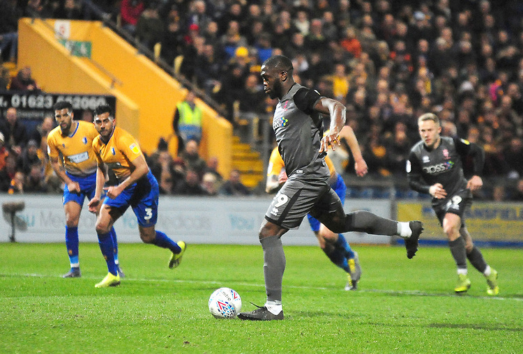 Lincoln City's John Akinde scores the opening goal for Lincoln City from the penalty spot to make it 1-1<br /> <br /> Photographer Andrew Vaughan/CameraSport<br /> <br /> The EFL Sky Bet League Two - Mansfield Town v Lincoln City - Monday 18th March 2019 - Field Mill - Mansfield<br /> <br /> World Copyright © 2019 CameraSport. All rights reserved. 43 Linden Ave. Countesthorpe. Leicester. England. LE8 5PG - Tel: +44 (0) 116 277 4147 - admin@camerasport.com - www.camerasport.com