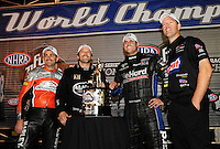 Nov. 13, 2011; Pomona, CA, USA; 2011 NHRA champions (from left) Eddie Krawiec , Del Worsham , Matt Hagan and Jason Line celebrate following the Auto Club Finals at Auto Club Raceway at Pomona. Mandatory Credit: Mark J. Rebilas-.