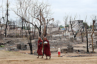Buddhist monks walk through what is left of Thi Ri Mingalar Muslim quarter in Meikhtila. The neighborhood was burned by Buddhist mobs following a quarrel between a Muslim gold shop owner and a Buddhist woman on March 20. Buddhists allege that later that day Muslims dragged a monk off a motorbike and tried to light him on fire in front of a mosque. Muslims claim the monk caught on fire when he was torching the mosque. More than 40 people were killed from the violence that resulted in hundreds of homes being destroyed over a course of a week - mainly Muslim - across 11 townships in Mandalay Division and Pegu Division.
