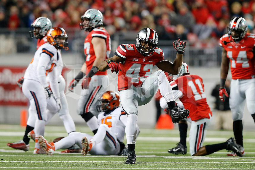 Ohio State Buckeyes linebacker Darron Lee (43) celebrates a tackle of Illinois Fighting Illini wide receiver Marchie Murdock (16) during the second quarter of the NCAA football game at Ohio Stadium on Nov. 1, 2014. (Adam Cairns / The Columbus Dispatch)