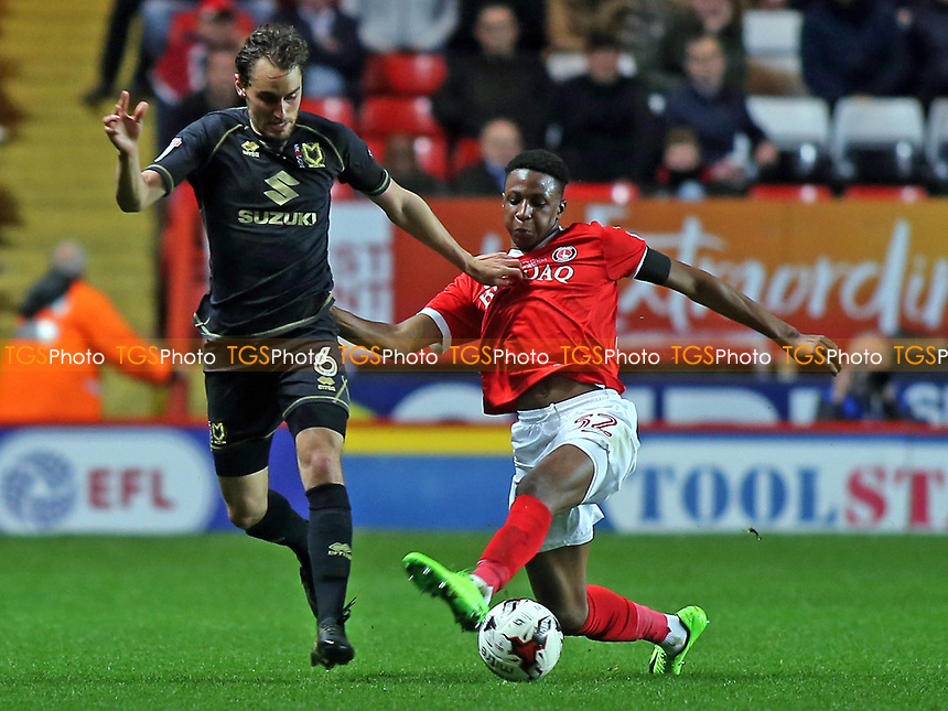 Ed Upson of MK Dons takes the ball past Charlton's Joe Aribo during Charlton Athletic vs MK Dons, Sky Bet EFL League 1 Football at The Valley on 4th April 2017
