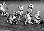 Bethel Park PA:  Defensive play with Mike Stewart 11 and Ray Tedesco 61 stopping the Highlander quarterback - 1970. Others in the photo; Don Troup 51, Joe Barrett 75, Dan Hannigan 64, Dennis Franks 66, Jim Dingeldine 73, Glenn Eisaman.  After Scott Streiner was injuried on the first play, the team rallied and came up just short of winning the game when they missed a two-point conversion late in the 4th quarter (7-6).  Defensive unit was one of the best in Bethel Park history only allowing a little over 7 points a game.